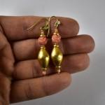 Orecchini in oro e antico corallo rosa